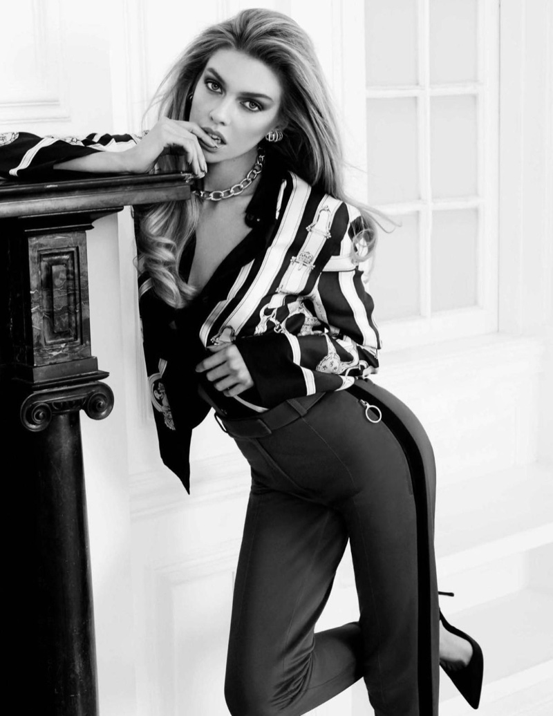 Stella Maxwell poses in striped prints for the editorial