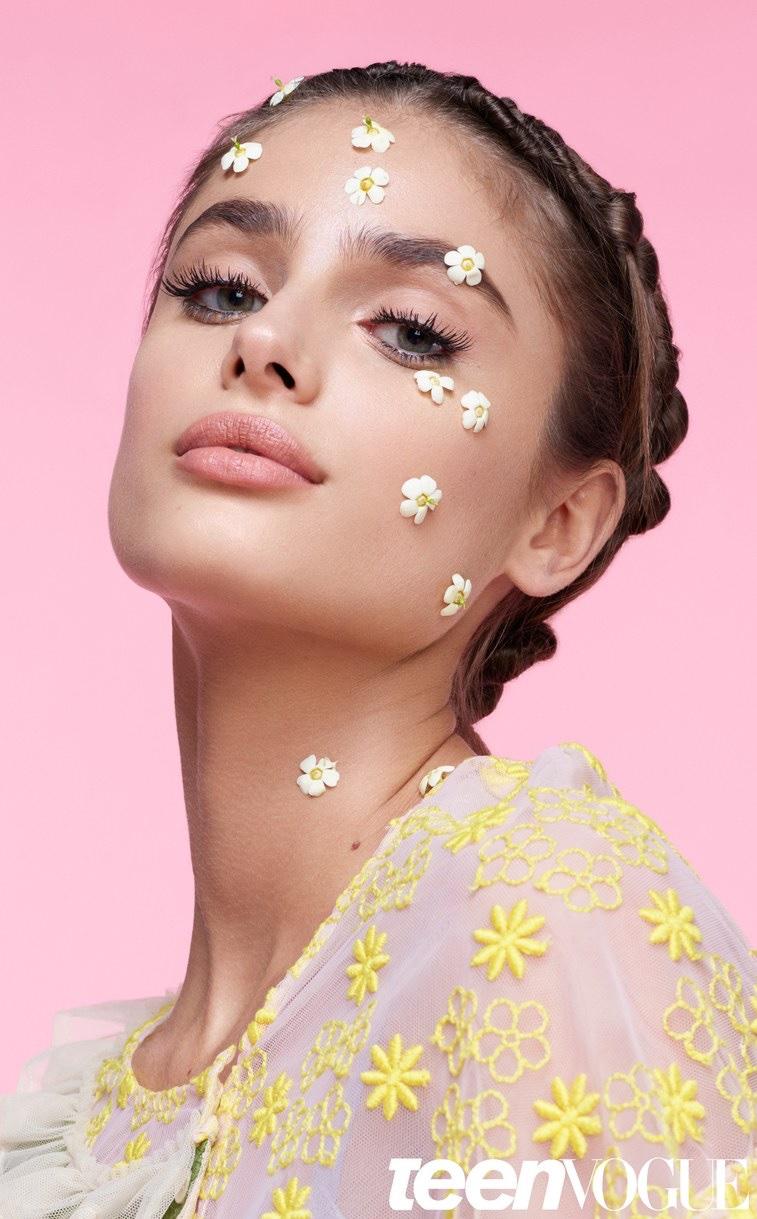 Embracing florals, Taylor Hill models Simone Rocha dress