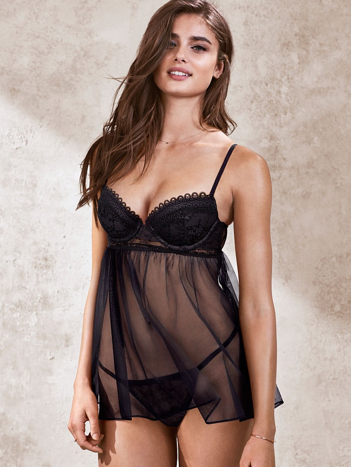 Taylor Hill flashes a smile in black negligee from Victoria's Secret