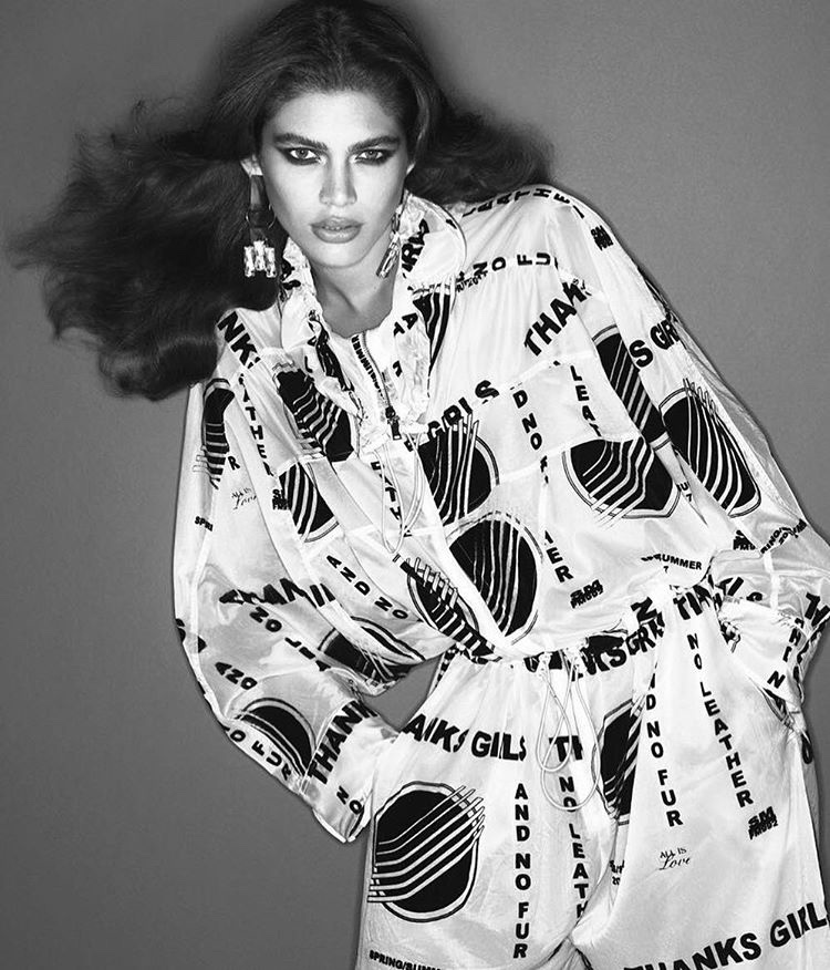 Valentina Sampaio wears graphic print coat in this black and white image