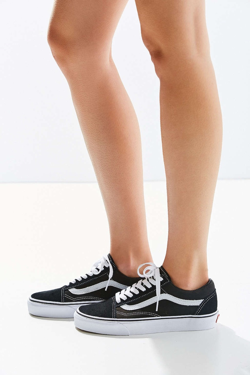 7825852978d2d8 The Classic Old Skool Sneaker features black and white contrast Channel  your inner skater girl in Vans sneakers