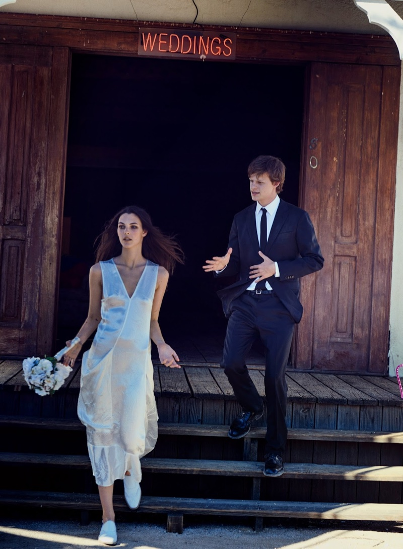Vittoria Ceretti wears an unconventional wedding look with Victoria Beckham dress and Hermes shoes