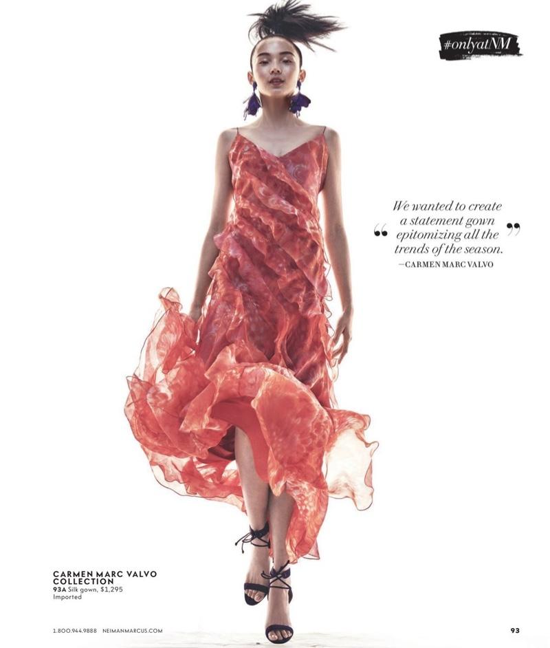 Xiao Wen Ju models Carmen Marc Valvo Sleeveless Floral Silk Ruffle Gown