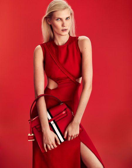 Model Yulia Terentieva poses in BOSS crepe dress and Clips bag