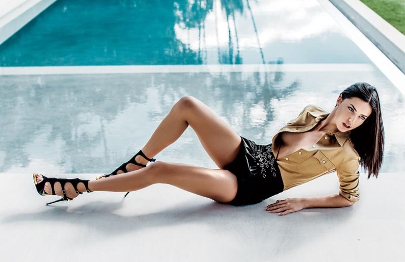 Adriana Lima models Miu Miu tops and shorts with Giuseppe Zanotti strappy sandals