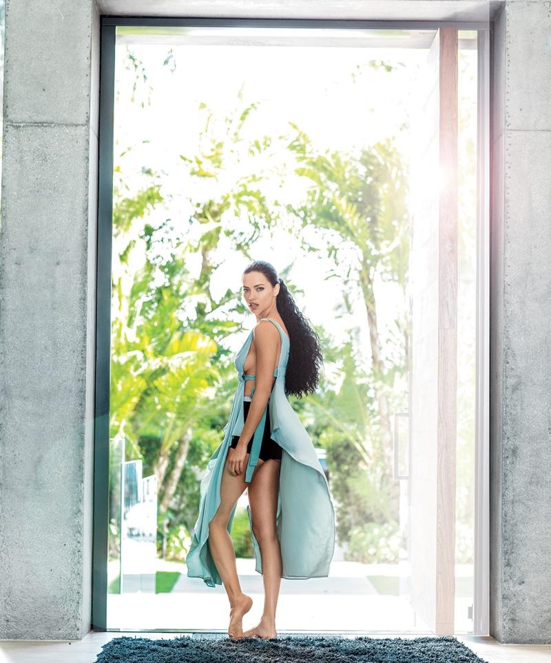 Flaunting her legs, Adriana Lima wears Fendi open-sided dress
