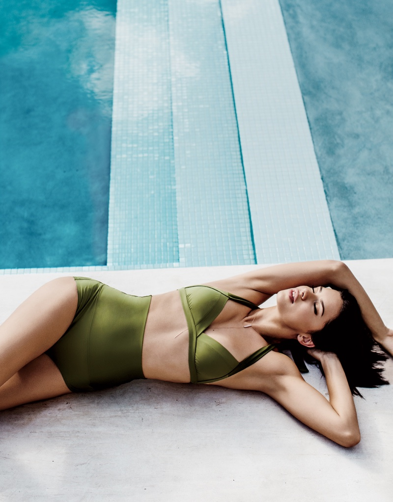 Flaunting her swimsuit body, Adriana Lima models Eres bikini top and bottoms