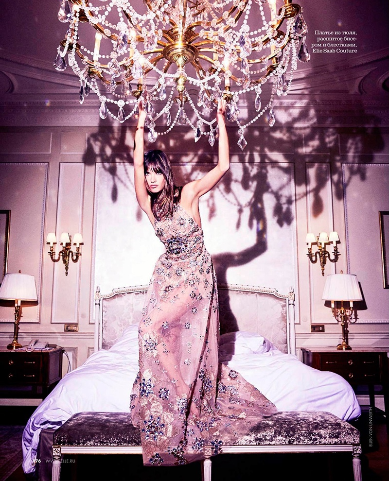 Hanging on a chandelier, Alessandra Ambrosio models Elie Saab Haute Couture gown with crystal embroidery