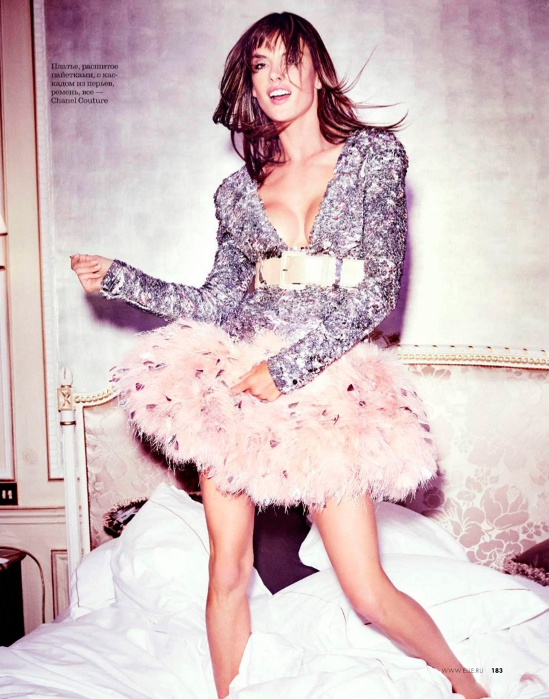 Flaunting her figure, Alessandra Ambrosio models Chanel Haute Couture jacket and skirt