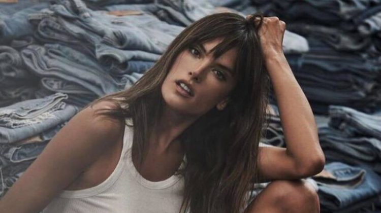 Looking casual chic, Alessandra Ambrosio wears white tank top and denim shorts from Re/Done