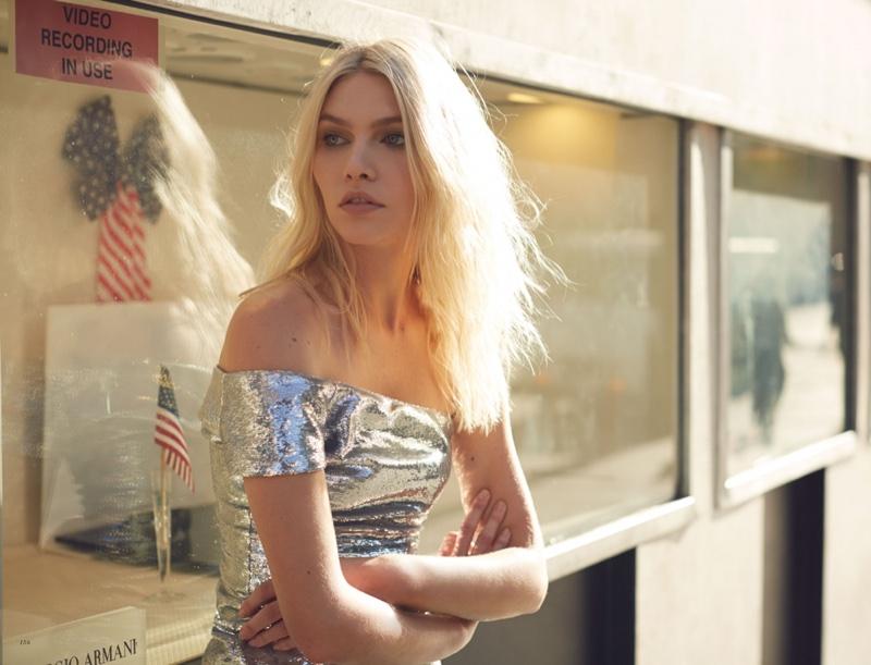 Model Aline Weber poses in off-the-shoulder silver minidress