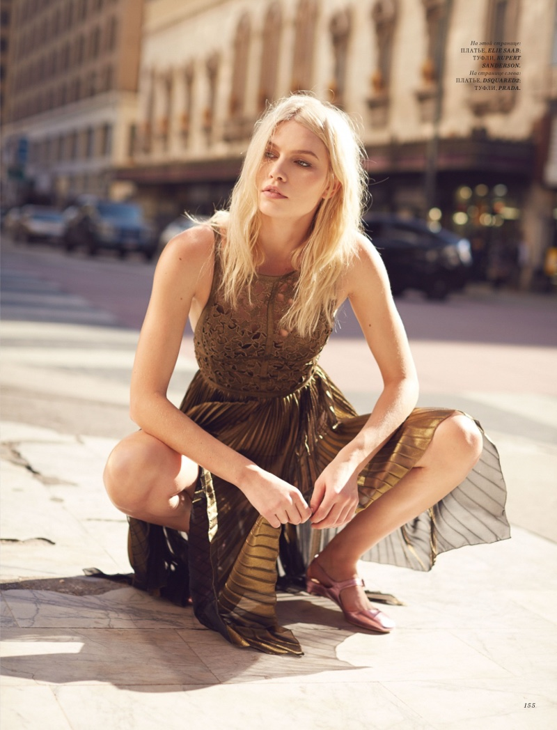 On the streets, Aline Weber poses in Elie Saab lace top and pleated skirt with Rupert Sanderson flats