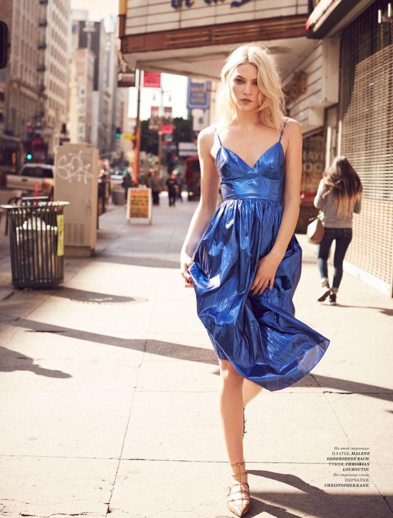 Wearing electric blue, Aline Weber models Malene Oddershede Bach dress and Christian Louboutin flats