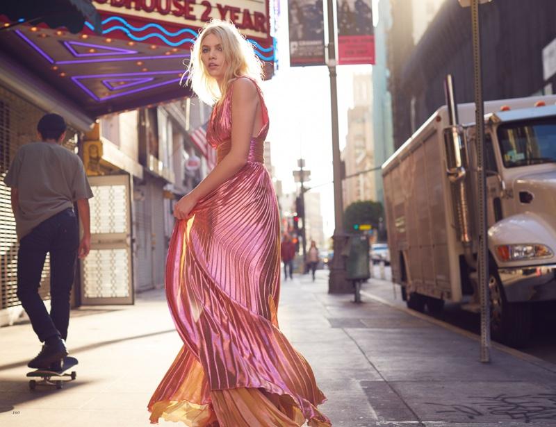 Looking pretty in pink, Aline Weber models pleated metallic dress