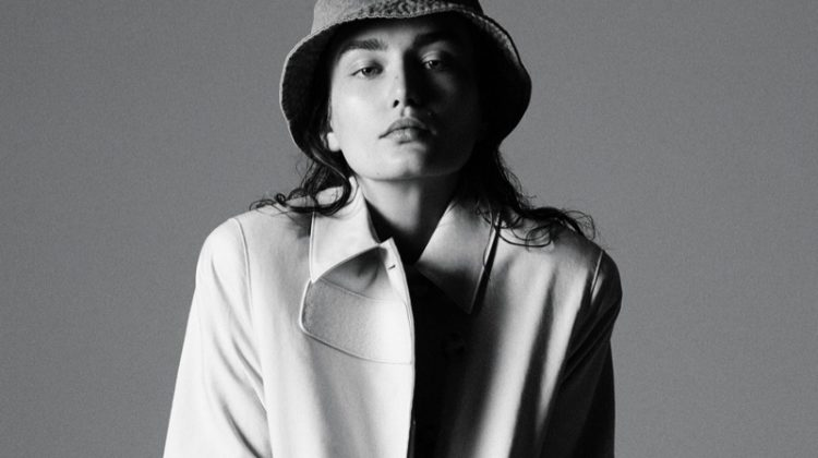 Model Andreea Diaconu poses in Prada trench coat with House of Lafayette hat