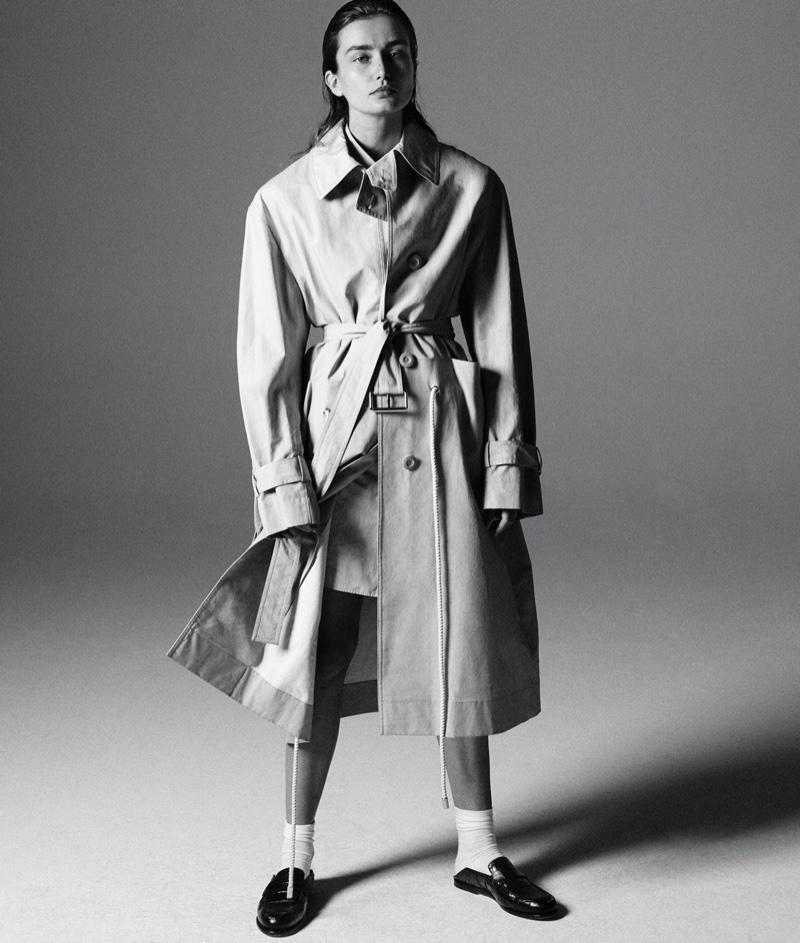 Looking elegant, Andreea Diaconu wears Marni trench, Jil Sander shirt, Falke socks and Loewe loafers