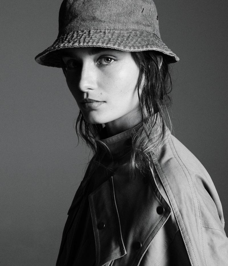 Getting her closeup, Andreea Diaconu wears Kenzo dress and House of Lafayette hat