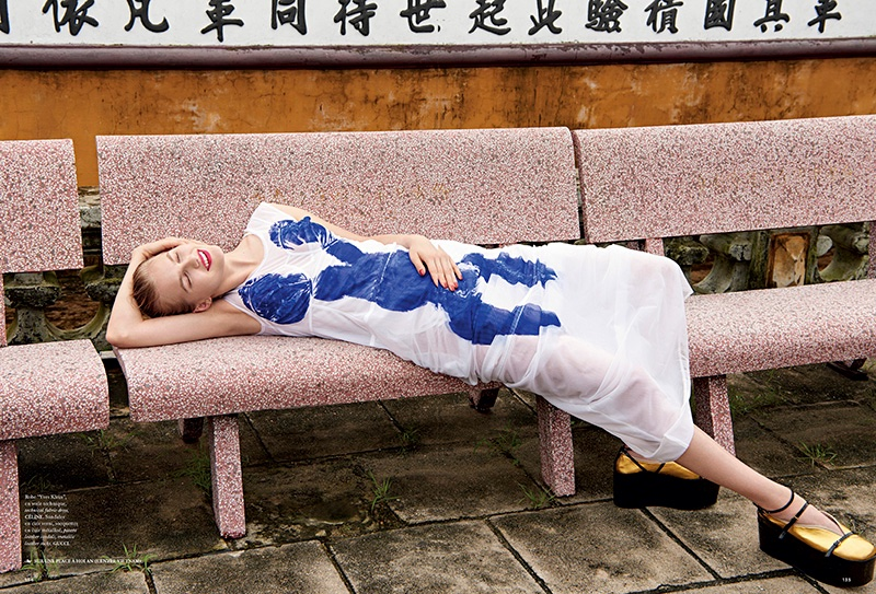 Lounging on a bench, Aneta Pajak models Celine dress and Gucci platforms