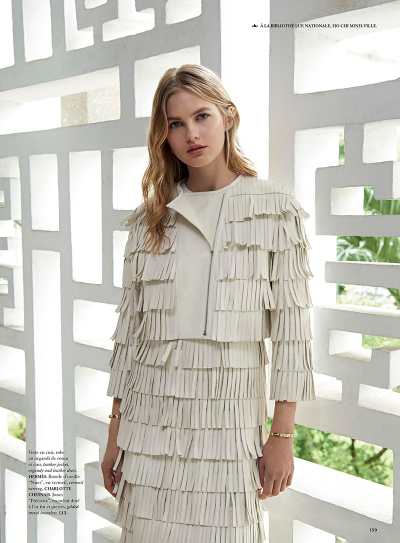 The model embraces fringe in Hermes leather jacket and skirt