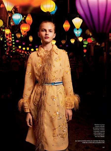 Posing in a street full of lanterns, the model wears Prada embellished coat and belt