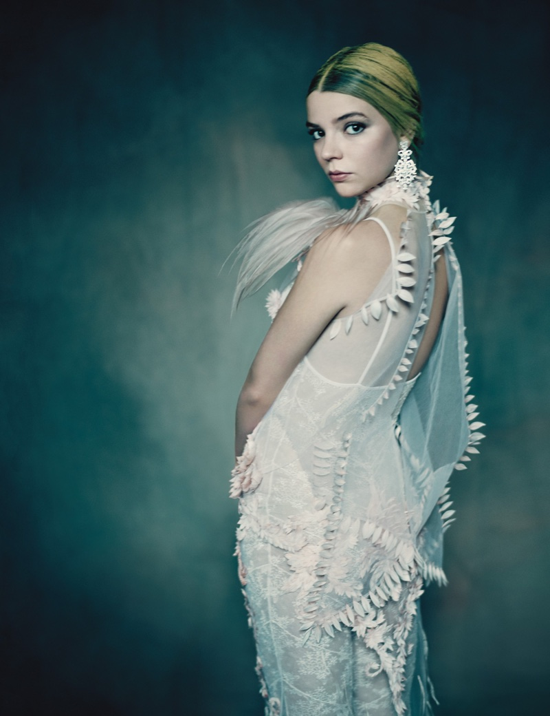 Dressed in white, Anya Taylor-Joy poses in Givenchy Haute Couture dress and Giampiero Bondino earrings