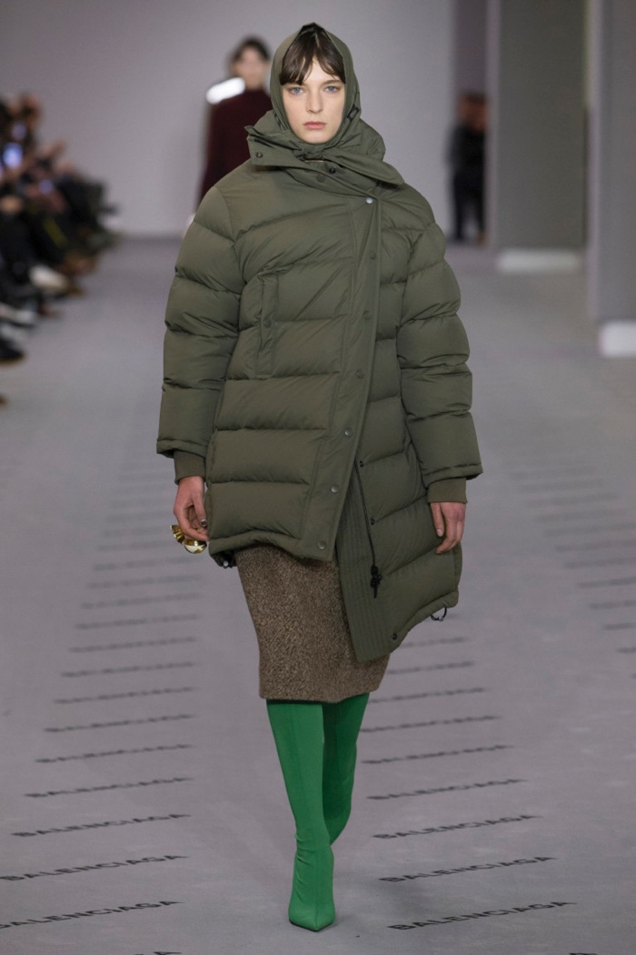 Puffer jacket over mid-length skirt and pointed toe boots from Balenciaga's fall-winter 2017 collection