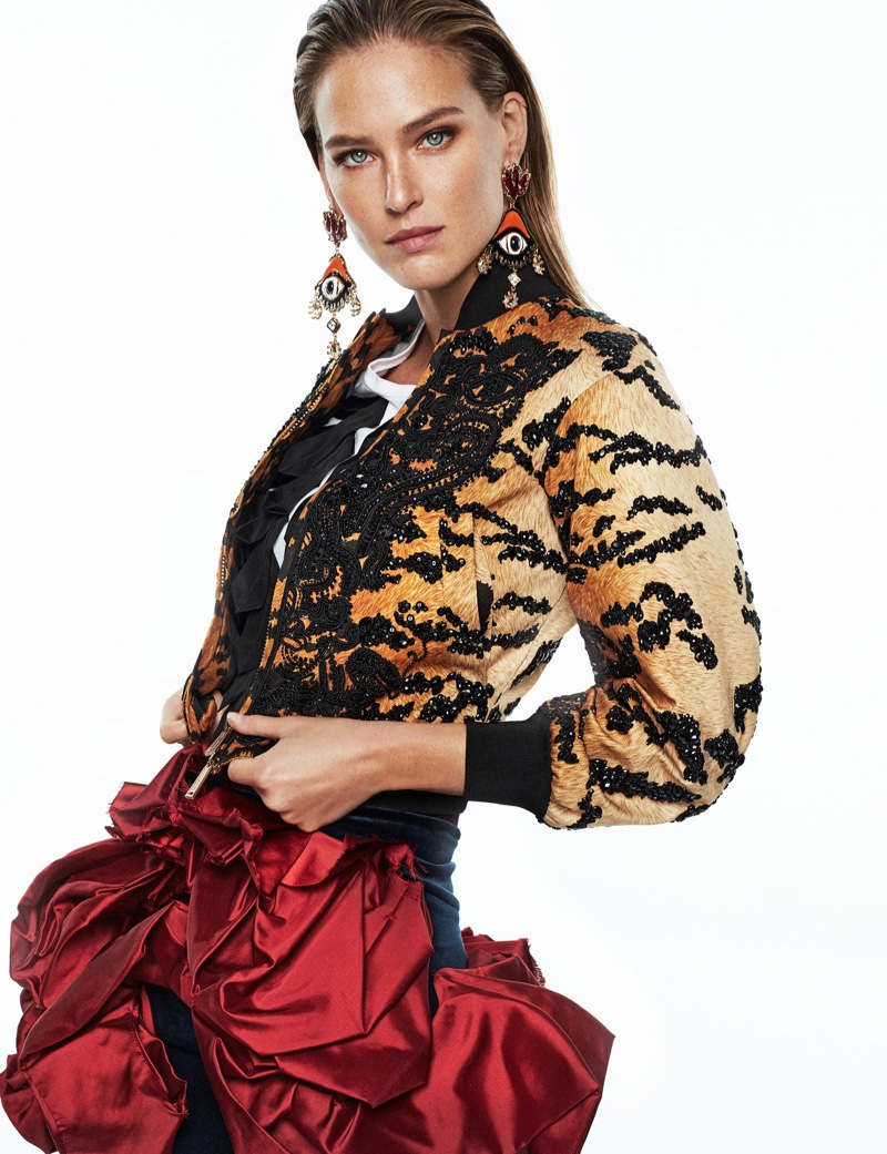 Model Bar Refaeli wears DSquared2 embroidered jacket and skirt with DSquared2 earrings