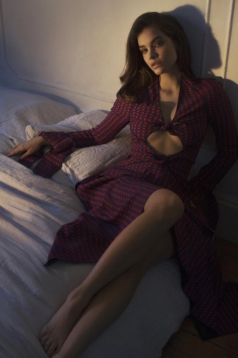 Posing in bed, Barbara Palvin wears Proenza Schouler dress
