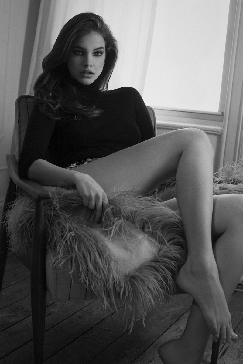 Barbara Palvin flaunts her legs in Prada sweater and shorts