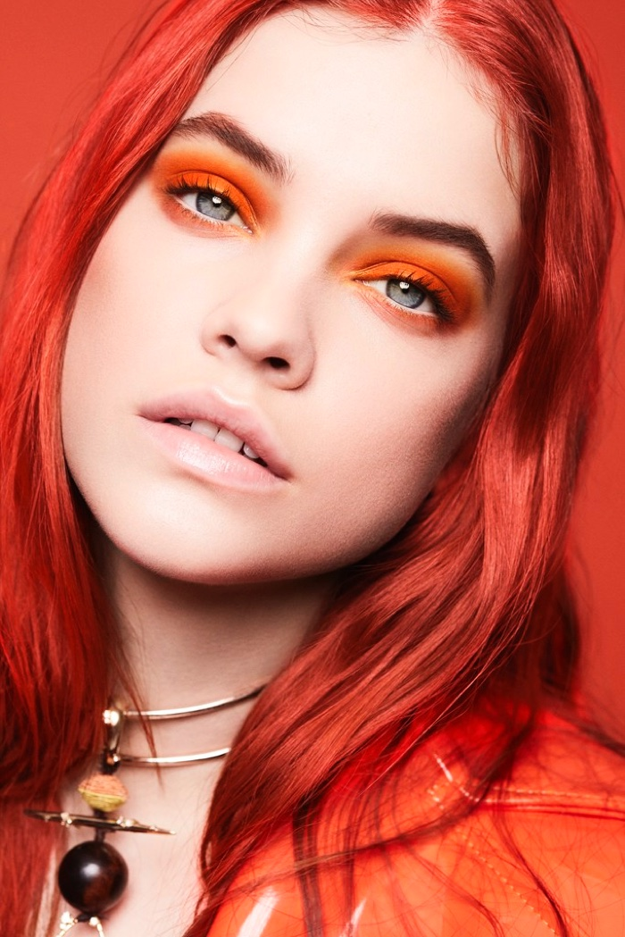 Barbara Palvin models red hairstyle with Christian Siriano coat and Alexis Bittar necklace