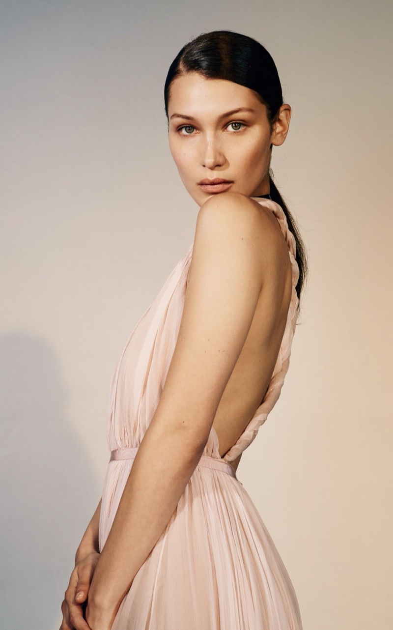 Looking pretty in pink, Bella Hadid poses in pleated Dior dress