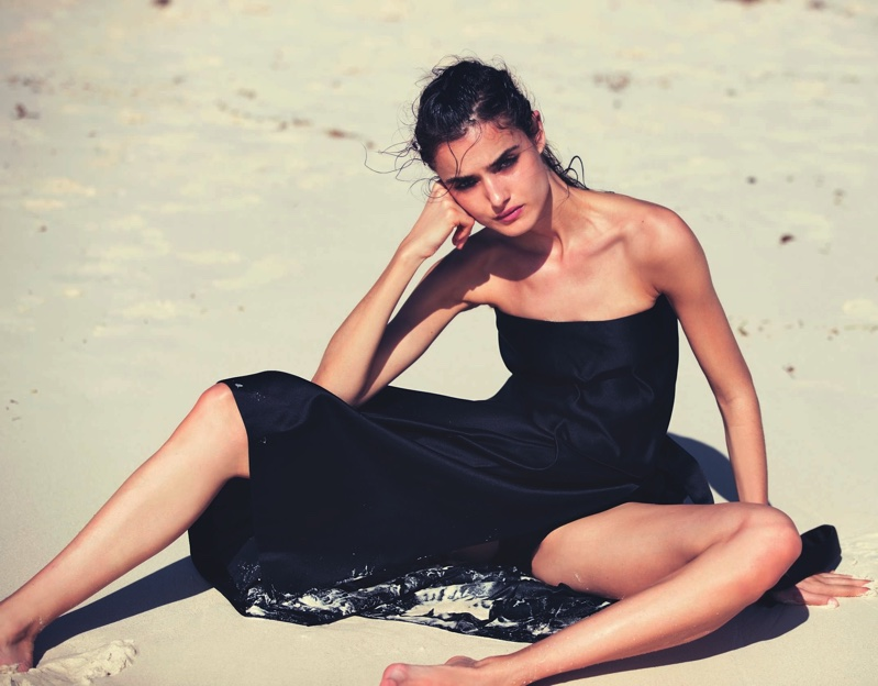 Clad in black, Blanca Padilla models Miu Miu bandeau top, skirt and shorts