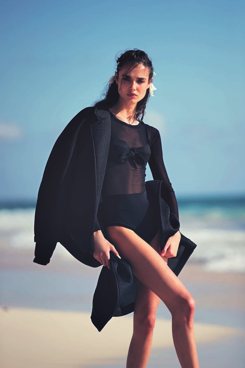 Blanca Padilla poses in Max Mara coat, bodysuit, bra and briefs