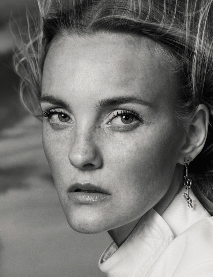 Photographed in black and white, Caroline Trentini shows off her freckles