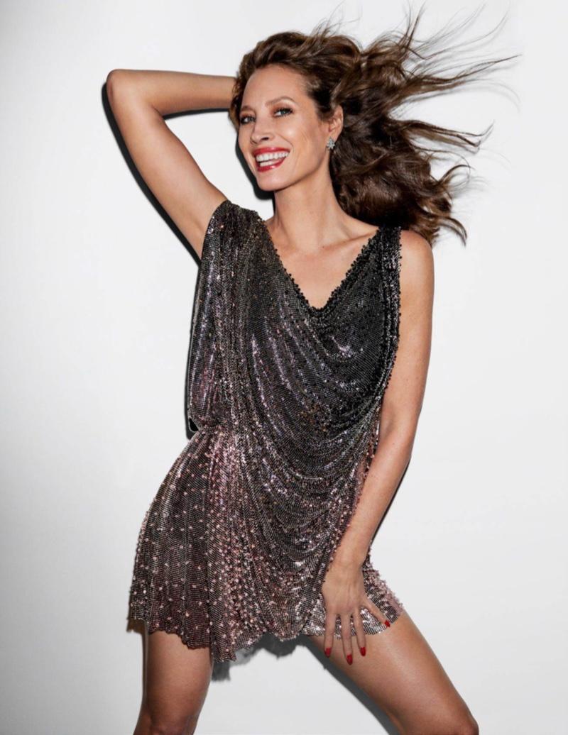 Flashing a smile, Christy Turlington rocks draped minidress from Atelier Versace