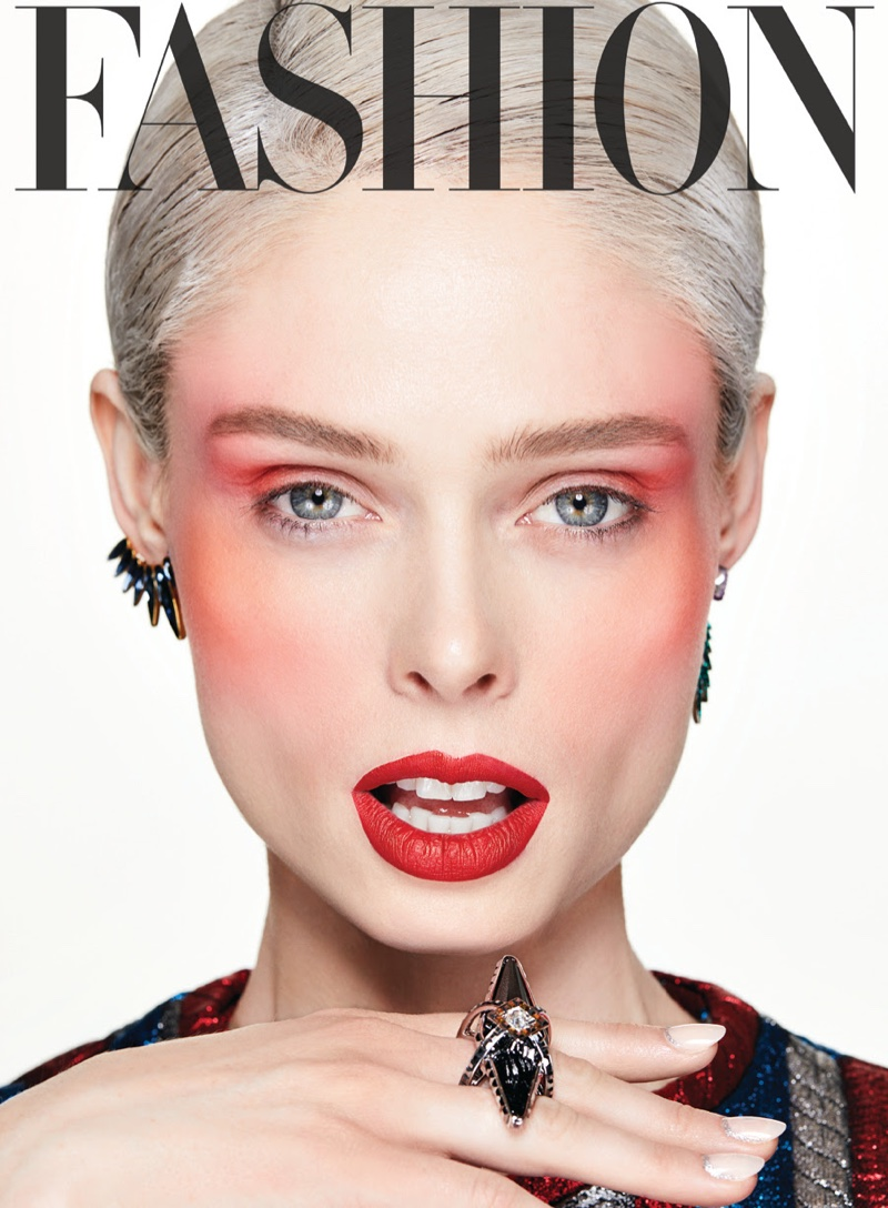 Wearing red blush and lipstick, Coco Rocha models Swarovski earrings and ring