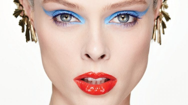 Coco Rocha models blue eyeshadow and red lacquered lips with Gillian Steinhart earrings