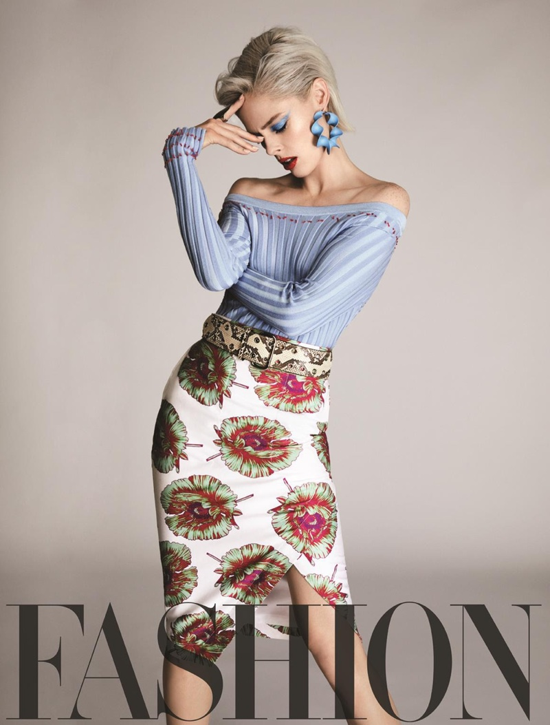 Coco Rocha poses in Altuzarra top, skirt, belt and earrings with Botkier ring
