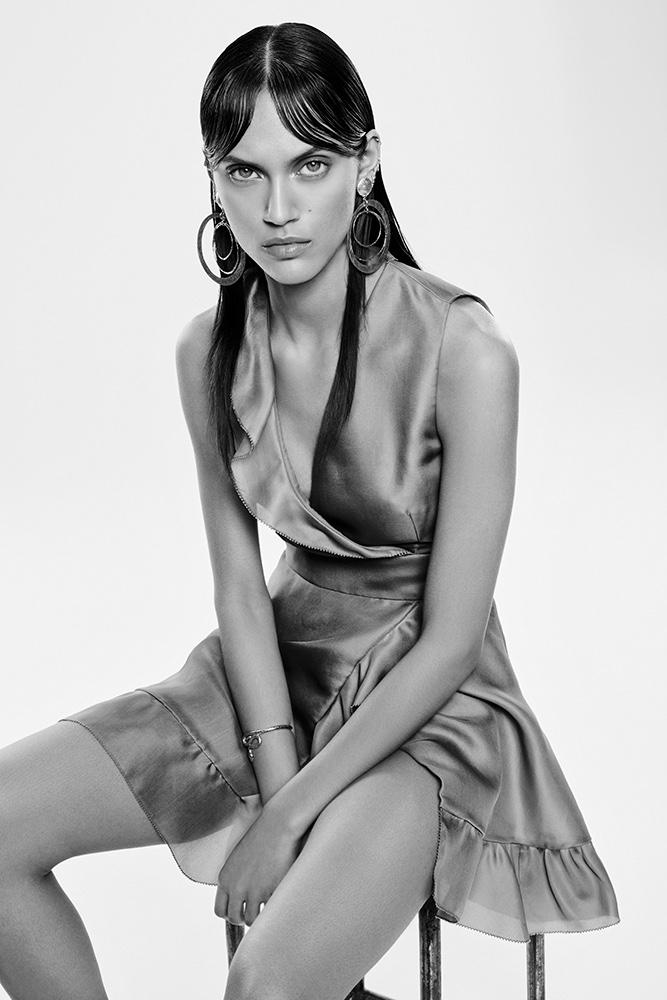 Photographed in black and white, Dalianah Arekion wears Emanuel Ungaro dress