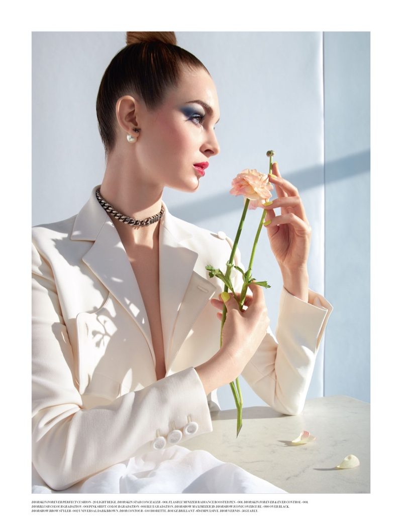 Laura Love models Dior jacket and jewelry