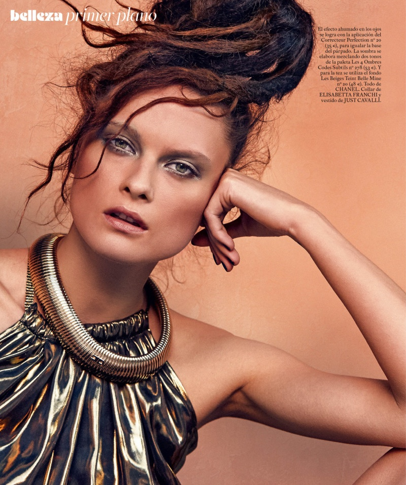 Model Elena Melnik looks sun-kissed with a Elisabetta Franchi necklace and Just Cavalli gold dress