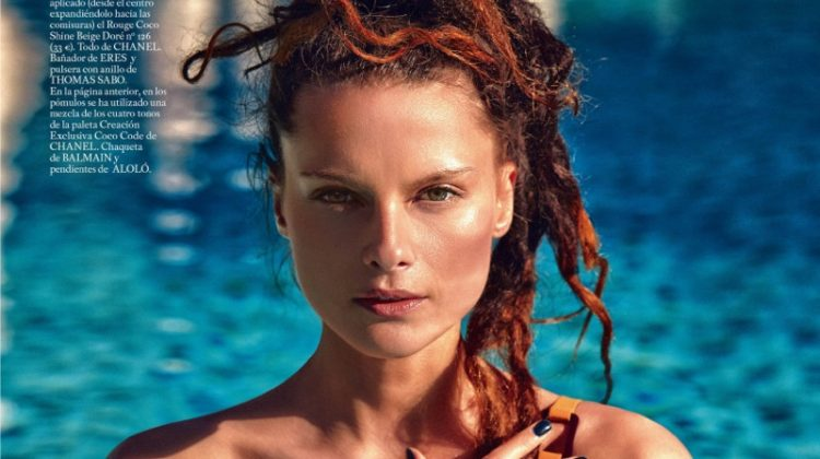 Posing in a pool, Elena Melnik models Eres one-piece swimsuit and dreaded hairstyle