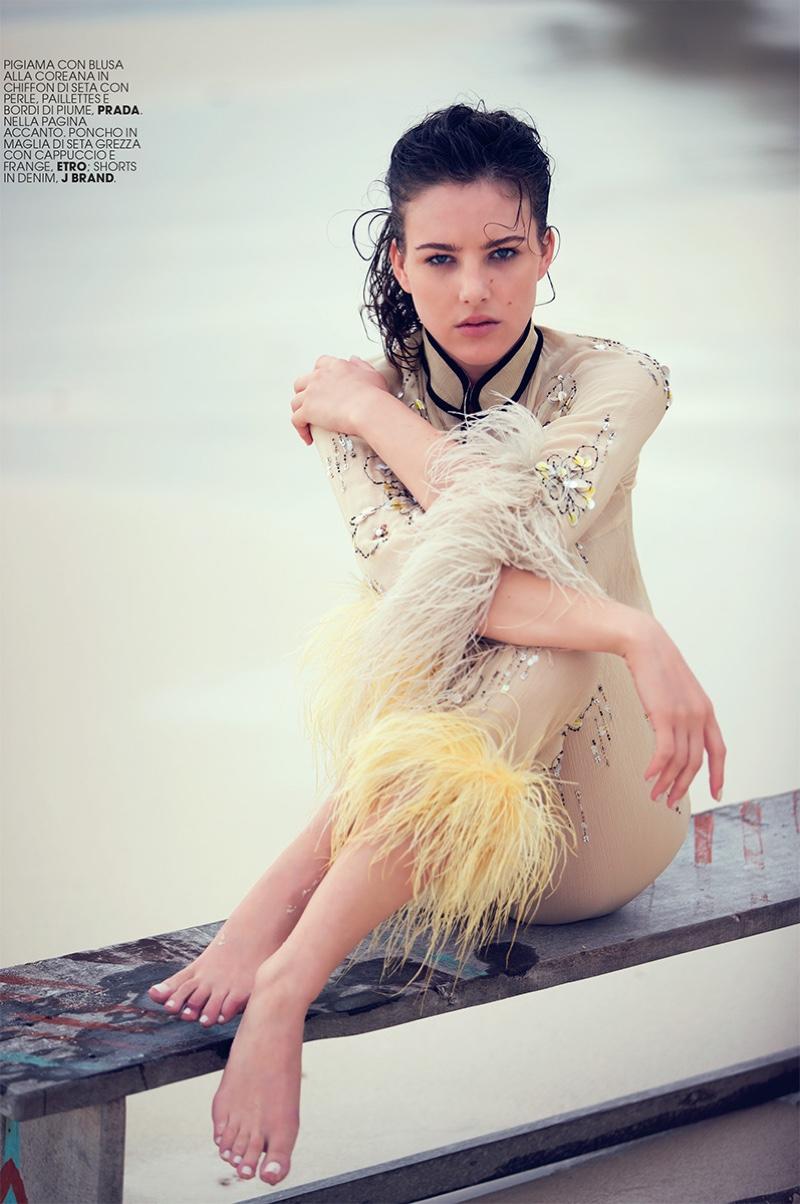 Eliza Cummings wears blouse and pants from Prada