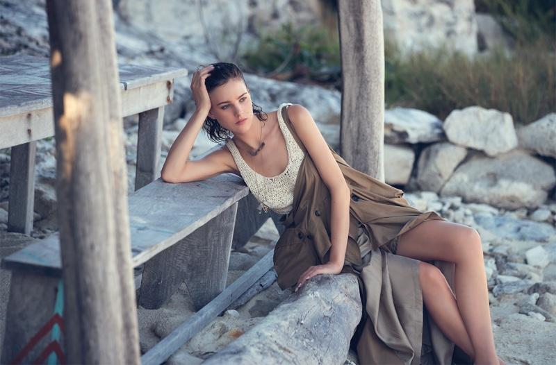 Posing on the beach, Eliza Cummings wears neutral hues