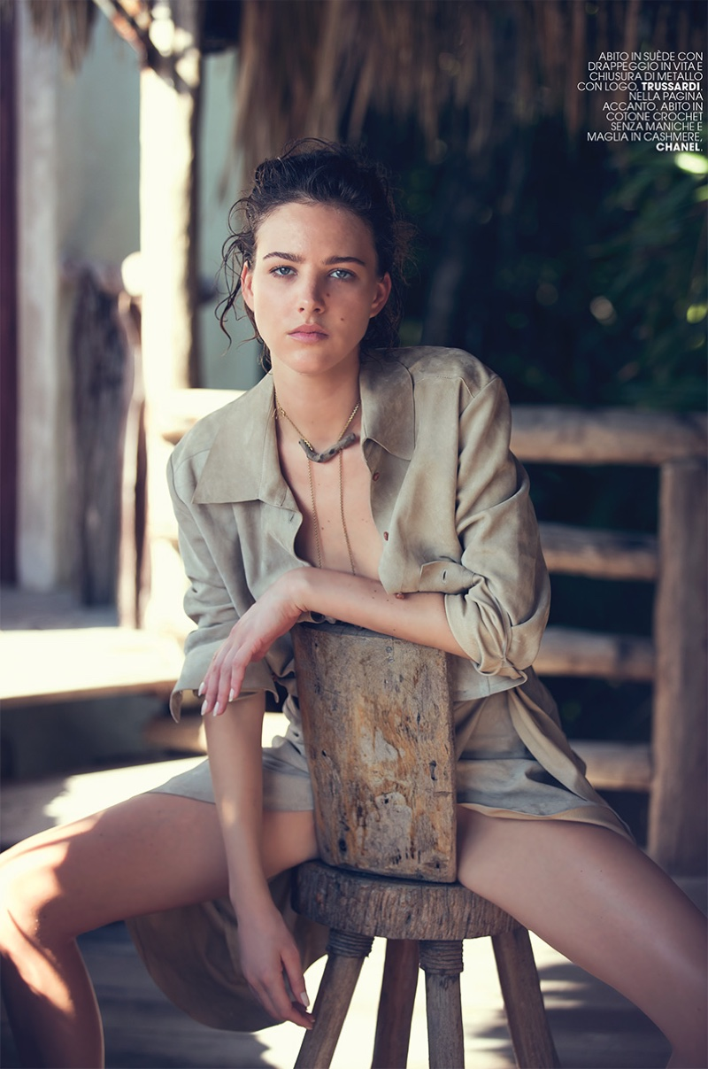 The model takes a seat in suede Trussardi jacket