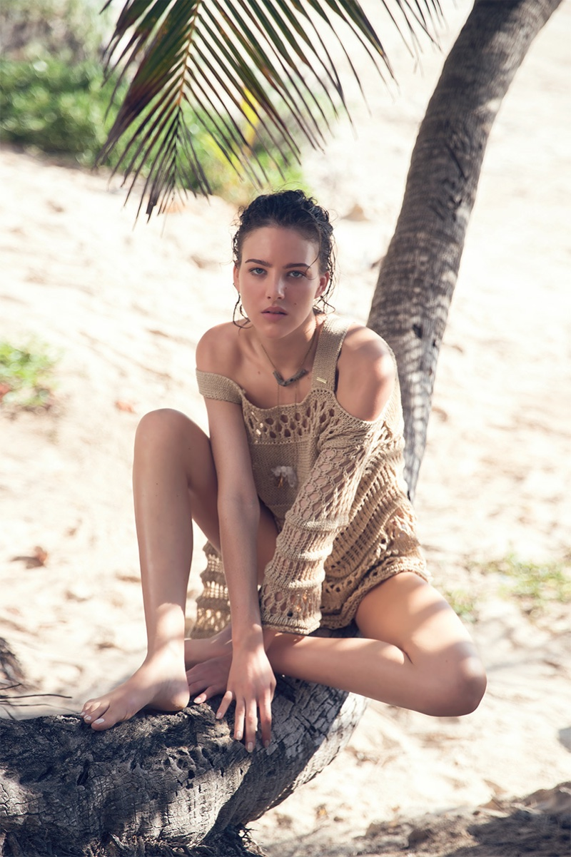 Eliza Cummings poses in crochet coverup from Guess by Marciano