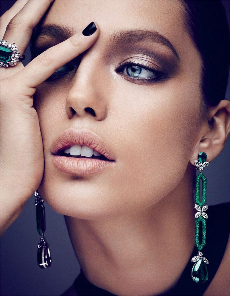Model Emily DiDonato poses in Fabio Salini earrings with Mikimoto ring and Roland Mouret top