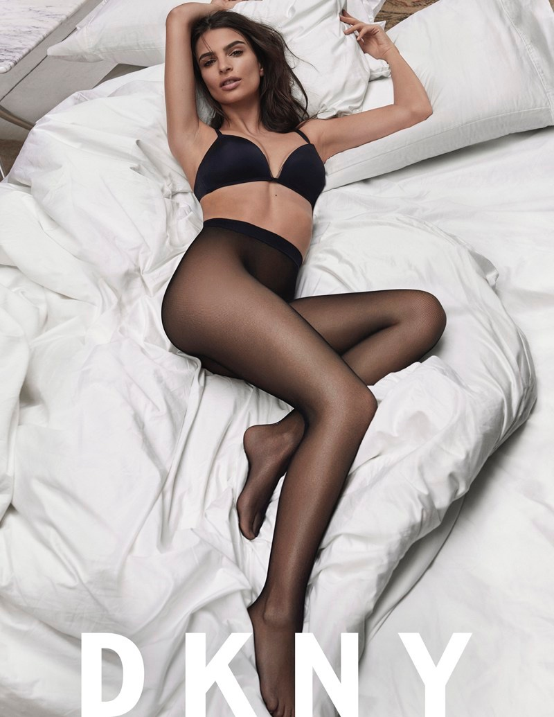Posing in bed, Emily Ratajkowski strips down in DKNY Intimates