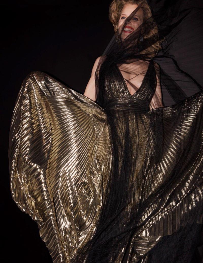 Eva Herzigova models gold pleated gown
