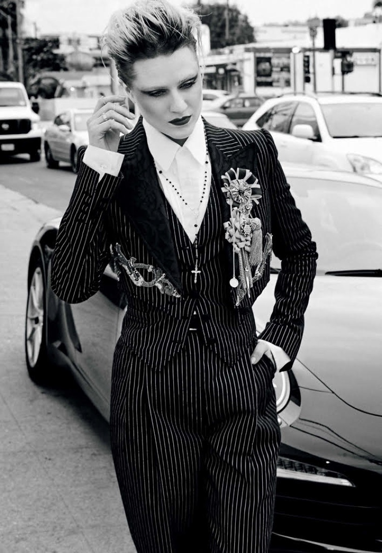 Embracing pinstripes, Evan Rachel Wood wears Dolce & Gabbana cotton suit and necklace with Gucci shirt